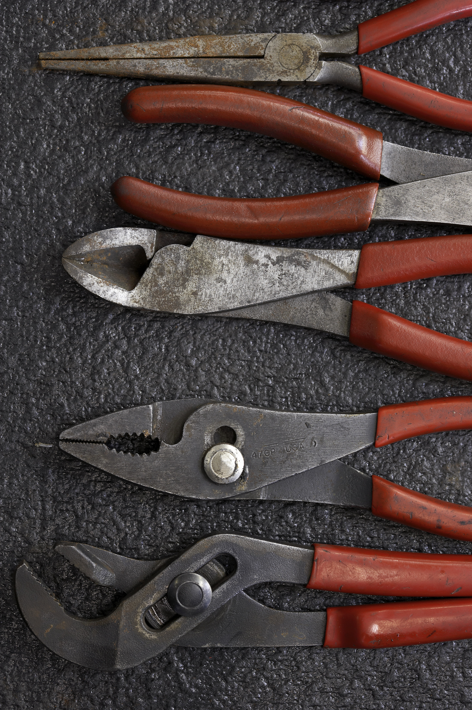 various tools such as pliers and clamps